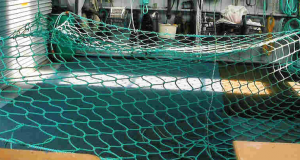 "5m x 5m x 6"" mesh Poly Prop cargo net being knitted"